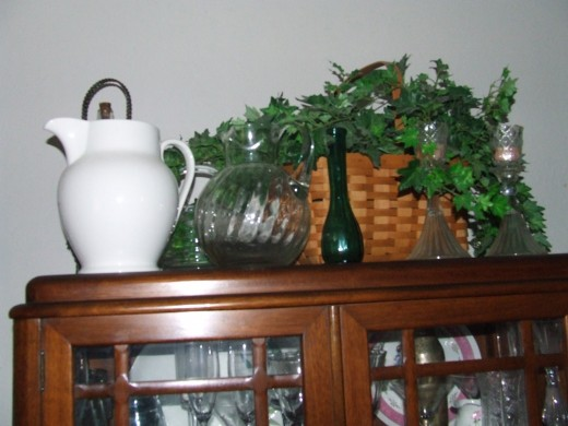 I try to store a few items on top of the china cabinet. Mostly water pitchers, so I always know where they are.