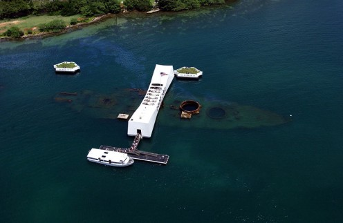 Aerial View of the USS Arizona Memorial with a US Navy (USN) Tour Boat, USS Arizona Memorial Detachment.