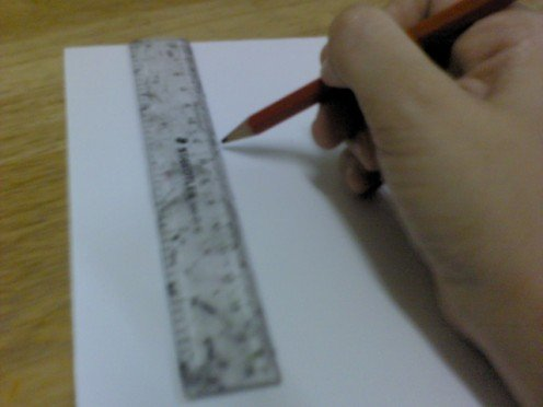 Measure white card 4cm x 12cm (height x length). Cut it out.