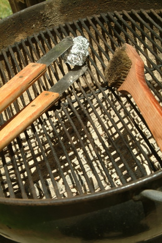 When last years grill is this dirty, it can discourage even the most seasoned of BBQ Masters. Using the handy aluminum foil technique can really speed-up the cleaning process! SEE GRILLING SHORTCUT #1.