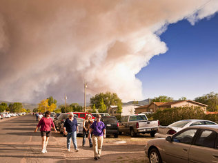The largest forest fire in Arizona history is causing a mass migration as town after town is burned to the ground, All agriculture in the area has been destroyed. This was also going on the same day of the game.