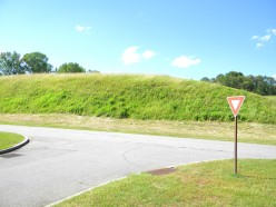 Construction of a highway caused the removal of much of the earth from this mound.  The main grounds of the complex is now safe from further destruction.