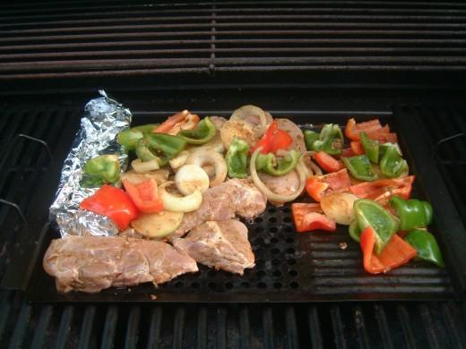 Pork Souvlaki, asparagus, peppers and onions