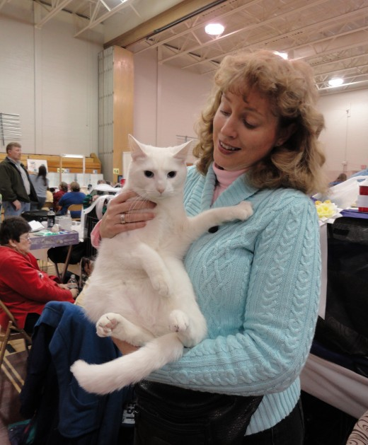 Image of Karen Neary Smithson holding her domestic short haired cat, Caspurr.