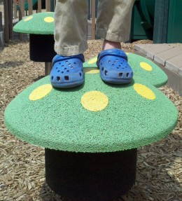 The little one mushroom hops in the tot area of the playground at Fullerton Park in Moorestown, NJ.