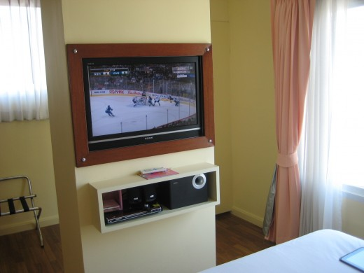 Big flat screen tv right in front of the bed with excellent multimedia sound system.