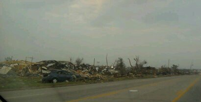 This Joplin tornado photo shows debris on 20th Street in Joplin MO following the EF5 tornado that hit on May 22, 2011.