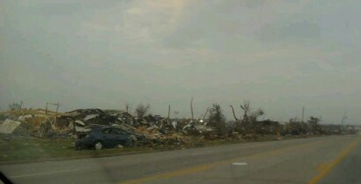 This Joplin tornado photo shows debris on 20th Street in Joplin MO following the EF5 tornado that hit on May 22, 2011.