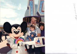 Mickey giving me the winning key! I won out of 90,000 people who walked through the gate, that week.