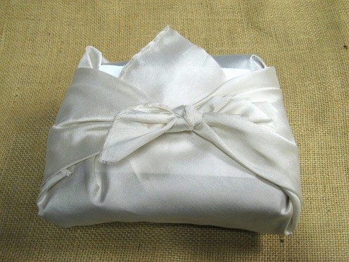 Consider different creative ways to present your gifts. Here, a pure silk handkerchief becomes a romantically luxurious wrapping. CCL D