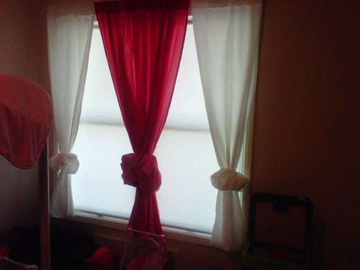 Pink @ White for a little girl's window. I placed hair bands around curtains to make Bows.By doing so it shorten curtain to window base
