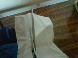 Cut a slit in seam of sheet pocket for the rod
