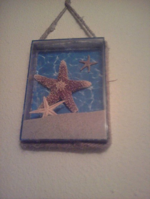 Starfish and sand wall plaque