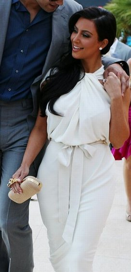 Kim Kardashian in the arms of her beau, Kris Humphries.
