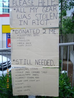 The handmade signs indicate what was taken during the riot and the appeal for replacements.