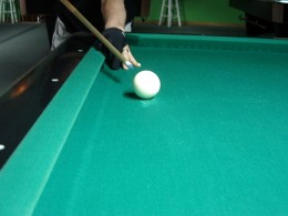 Photo 4: A player about to break on the right hand side of the table, from behind the head-line.