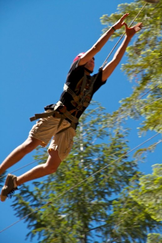 Leaping from the Confidence Pole at the COPE course.