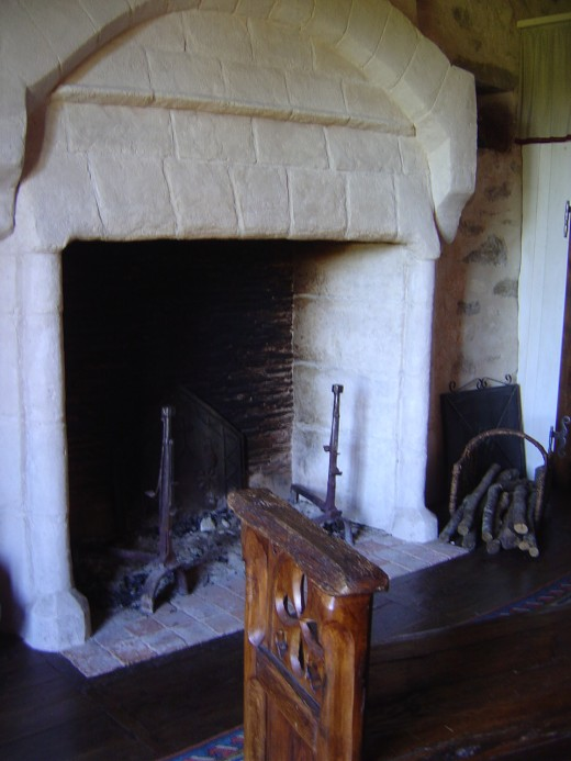 The massive fireplace of the red bedroom
