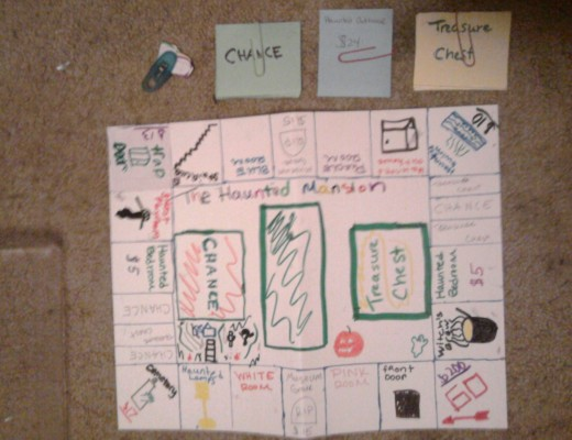 This is a board game that me and 2 of the kids I babysit made. Fashioned after Monopoly, it has a bunch of haunted house themed stuff. They named it The Haunted Mansion.