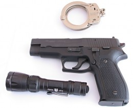 Pistol and handcuffs.