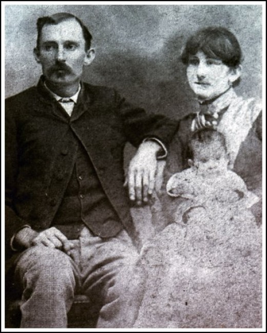 Miller, his wife Sallie and child, probably son Claude C. Miller; circa 1890s.