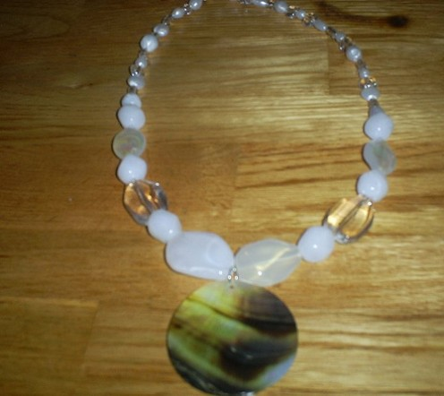 Here is what the final necklace looks like.  I made this necklace using white acrylic beads, beading wire, and a shell.