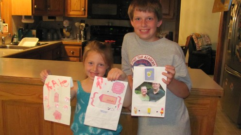 Bridgette and brother Casey decorating luminary bags.