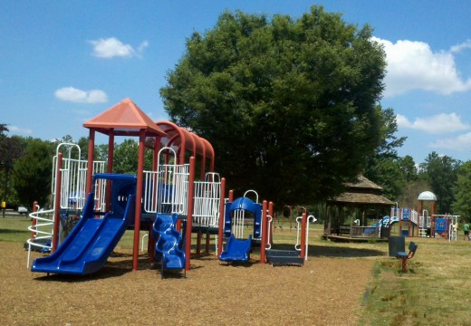 Part of the largest playground at Laurel Acres with the gazebo and mid-sized playground in the background.