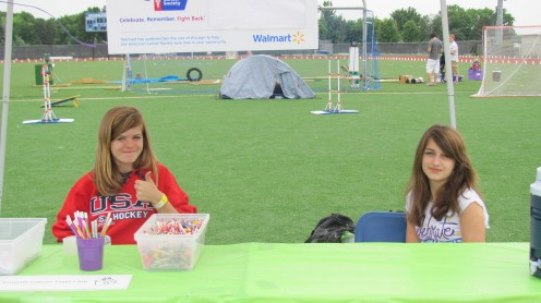 """My niece and her buddy manning our """"spin the wheel"""" at our table"""