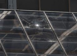 Shattered glass by the fall of the two women.