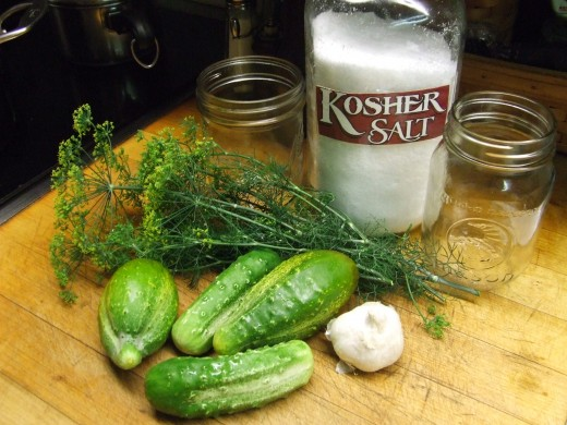 Cucumbers, Dill, Garlic, Kosher Salt and Clean Jars and Lids.