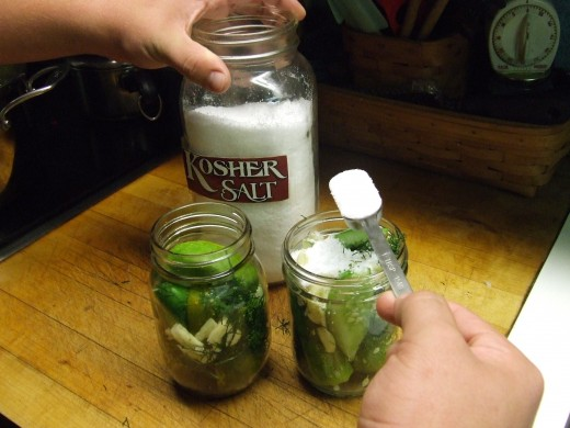 Add 1/4 to 1/2 teaspoon Salt to a Pint Jar and 1 teaspoon of Salt to a Quart Jar.