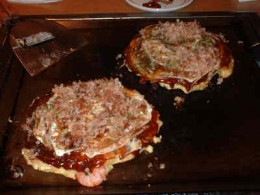 Okonomiyaki a kind of savory pancake.