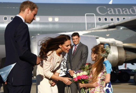 Flowers for the Duchess as the pair arrive at the airport in Charlottetown