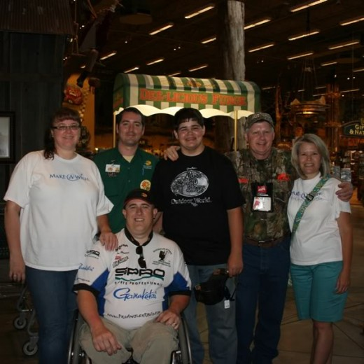 Jonathon pictured with Mitchell and his family on their Bass Pro shopping spree.