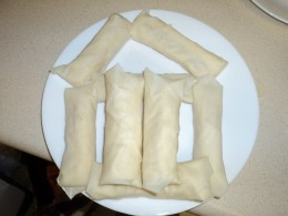 Plate of ready for frying banana lumpias