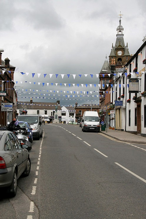 Lockerbie High Street. The town hall clock tower is prominent on the right.