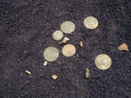 Silver quarters, dime, and an Indianhead penny