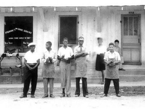 IN FRONT OF SHOE REPAIR SHOP IN FARRIDAY LA.--1950