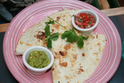 A basic cheese quesadilla with home made salsa and guacamole.  New Mexico style, of course!!  Fresh from the kitchen!