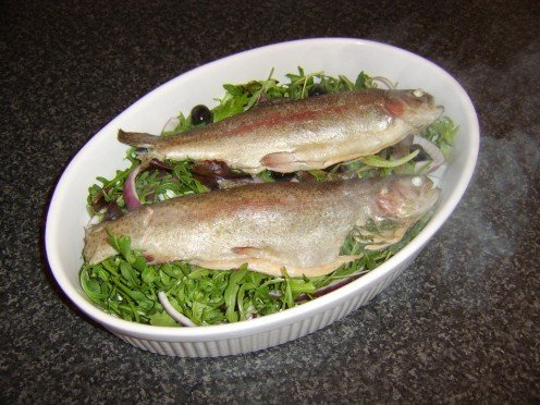 Whole rainbow trout steamed in white wine