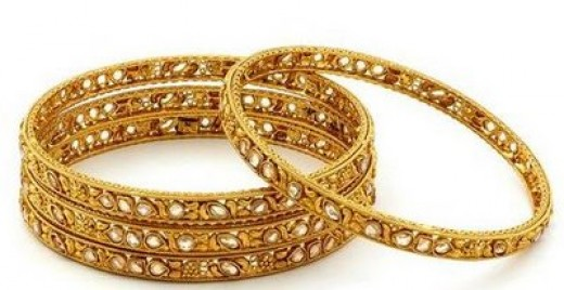 Gold and diamond bangles from mattersofstyleblog.com
