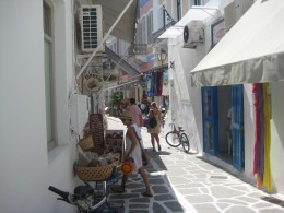 A small street in Paros with little shops.