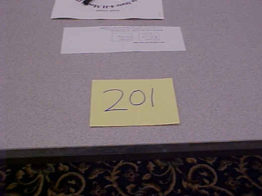 Some shows place your names on your tables; others assign you exhibitor numbers. It's important to check with the registration desk to learn what your exhibitor number is.