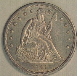 Seated Liberty on the front of the silver dollar.