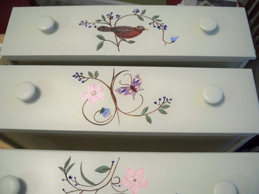 A whimsical theme from nature is an often used design on painted furniture.