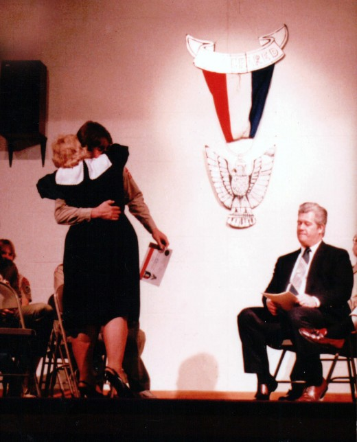 Image of my mother hugging my brother, Billy, after he receives the rank of Eagle Scout.  Both my parents were scout leaders.  I also attained the rank of First Class.