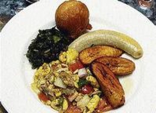 ackee & salt fish served ith fried ripe plantains, boiled green banana, fried dumpling and calaloo