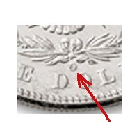 The Mint Mark on the Morgan Silver Dollar is on the back under the wreath.