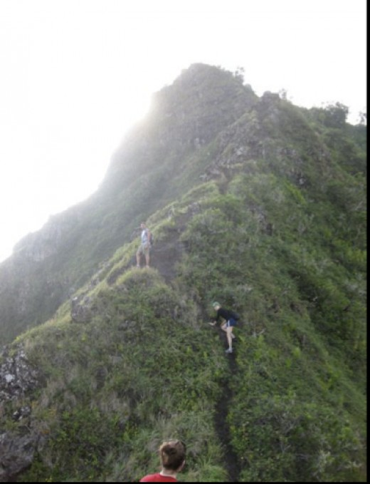 CJ and friends climbing Pu Manana, which is rated as one of the most dangerous hikes on the island.  He is the one standing about mid-way in the picture.